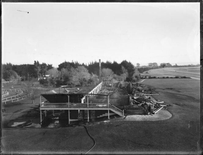 Grandstand damaged by fire, possibly at Riccarton Racecourse, Christchurch. Photograph taken circa 1919.jpg
