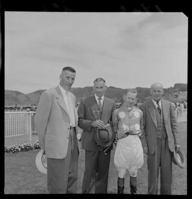 16 Jan 1960 From left to right, H G Adams, P G Henwood with cup, jockey W A Smith and Mr Arnott after presentation of the cup for winning horse.jpg