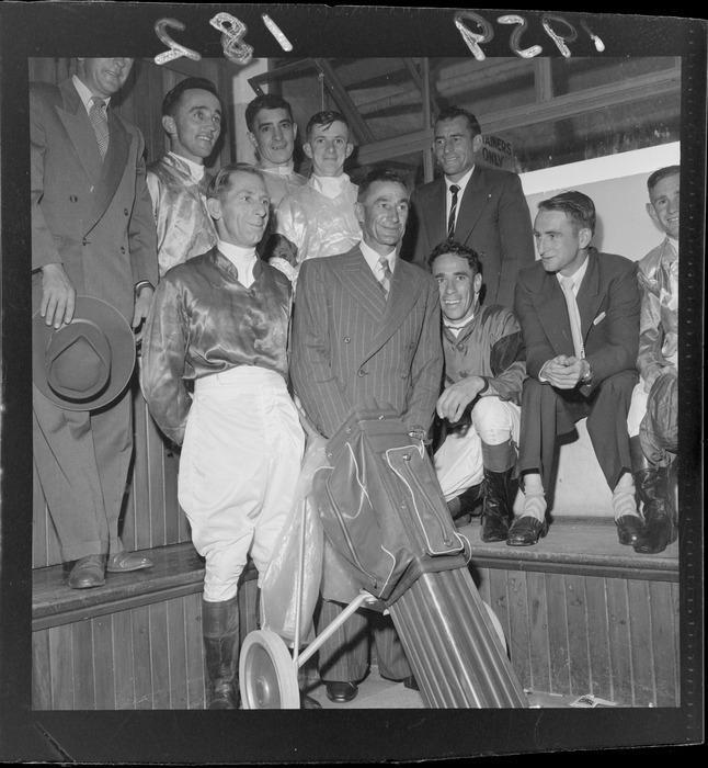 17 Jan 1959 W J Broughton with other jockeys after a presentation.jpg